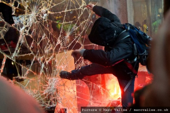 LONDON, UNITED KINGDOM – 10.11.10. Student protesters and police clash outside the Conservative Party headquarters at Millbank in central London on Wednesday 10th November 2010. Early in the day 50,000 students and supporters marched against the governments plans to rises tuition fees to £9,000 per year. (Photo by Marc Vallée/marcvallee.co.uk) © Marc Vallée, 2010. All rights reserved.